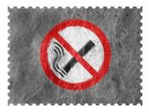 No smoking sign drawn at paper postage stamp — Stock Photo