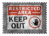 Restricted area sign painted on paper postage stam — Stock Photo
