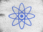 Atom symbol painted on — Stock Photo