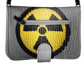 Nuclear radiation symbol painted on crocodile skin purse — Stock Photo