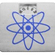 Atom symbol painted on painted on balance - Stock Photo