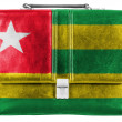 Togo flag painted on small briefcaseor leather handbag — Stock Photo