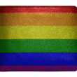 Gay pride flag painted on leather wallet — Stock Photo #23406878