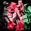 Royalty-Free Stock Photo: Afghanistan flag painted on pieces of torn paper on black background