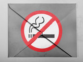 No smoking sign drawn at painted on grey envelope — Stock Photo