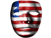 Liberia. Liberian flag painted on theater plastic mask — Stock Photo