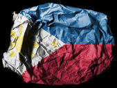 Philippine flag painted on crumpled paper on black background — Stock Photo