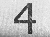 4. Four number painted on bubblewrap — Stock Photo