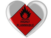 Highly flammable sign drawn on painted on glossy heart icon — Stock Photo