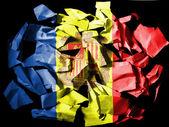黒の背景に引き裂かれた紙の作品に描かれたアンドラの国旗 — ストック写真