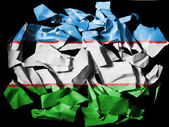 Uzbekistan flag painted on pieces of torn paper on black background — Stock Photo