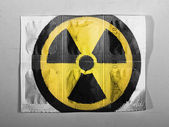 Nuclear radiation symbol painted on painted on pills — Stock Photo