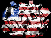 Liberia. Liberian flag painted on pieces of torn paper on black background — Stock Photo