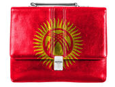 Kyrgyzstan flag painted on small briefcaseor leather handbag — Stock Photo