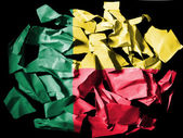 Benin. Benini flag painted on pieces of torn paper on black background — Stock Photo