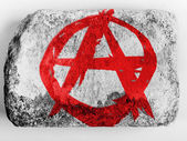 Anarchy symbol painted n painted on brick — Stock Photo