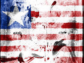 Liberia. Liberian flag painted on grunge wall — Stock Photo