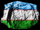 Uzbekistan flag painted on crumpled paper on black background — Stock Photo