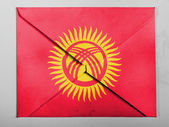 Kyrgyzstan flag painted on grey envelope — Stock Photo