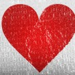 Red Heart symbol painted on painted on bubblewrap - Zdjęcie stockowe