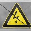 Electric shock sign painted on painted on grey envelope — Stock Photo
