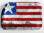 Liberia. Liberian flag painted on brick — Stock Photo