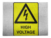 High voltage sign drawn at painted on carton box — Stock Photo