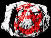 Anarchy symbol painted on crumpled paper on black background — Stock Photo
