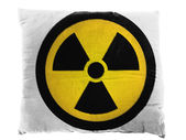 Nuclear radiation symbol painted on pillow — Stock Photo