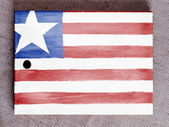 Liberia. Liberian flag painted over wooden board — Stock Photo