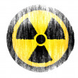 Stock Photo: Nuclear radiation symbol drawn on white background with colored crayons