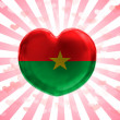 Burkina Faso flag painted on glass heart on stripped background — Stock Photo