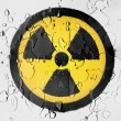 Nuclear radiation symbol painted on covered with water drops — Stock Photo #23420728