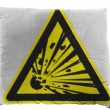 Explosive sign drawn on painted on pillow — Stock Photo #23420930