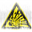 Explosive sign drawn on drawn on white background with colored crayons — Stock Photo #23421982