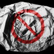 Stock Photo: No smoking sign drawn at painted on crumpled paper on black background