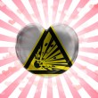 Explosive sign drawn on painted on glass heart on stripped background — Stock Photo #23423262