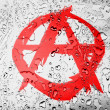 Anarchy symbol painted on covered with water drops - Stock Photo