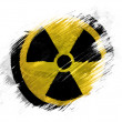 Stock Photo: Nuclear radiation symbol painted on painted with brush on white background
