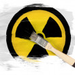 Stock Photo: Nuclear radiation symbol painted on painted with brush over it