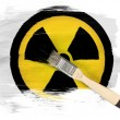 Nuclear radiation symbol painted on painted with brush over it — Stock Photo #23426234