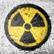 Nuclear radiation symbol painted on covered with water drops — Stock Photo #23428068