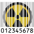 Stock Photo: Nuclear radiation symbol painted on barcode surface