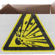Explosive sign drawn on painted on carton box or package — Stock Photo