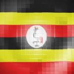 Uganda flag on wavy plastic surface — Stock Photo #23429704