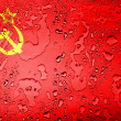 The USSR flag painted on  covered with water drops - Stock Photo