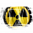 Stock Photo: Nuclear radiation symbol painted on painted with watercolor on wet white paper