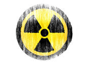 Nuclear radiation symbol drawn on white background with colored crayons — Stock Photo
