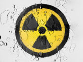 Nuclear radiation symbol painted on covered with water drops — Stock Photo