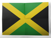 Jamaica flag painted on simple paper sheet — Stok fotoğraf